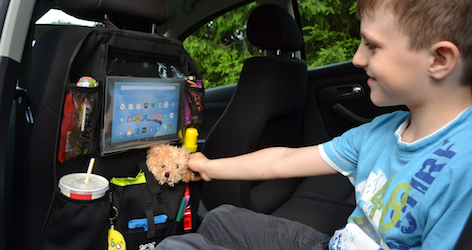 kid enjoying his car back seat organizer with tablet holder